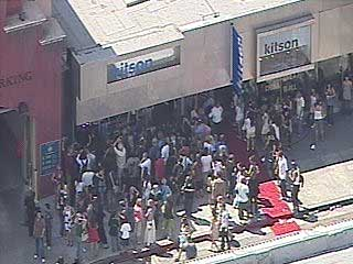 Paris Hilton drew a large crowd and stopped traffic during an appearance at Kitson on Thursday afternoon.