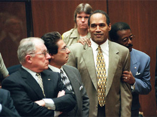 "<div class=""meta image-caption""><div class=""origin-logo origin-image ""><span></span></div><span class=""caption-text"">Attorney Johnnie Cochran Jr. holds onto O.J. Simpson as the not guilty verdict is read in a Los Angeles courtroom Tuesday morning, Oct. 3, 1995. Left is F. Lee Bailey and second from left is Robert Kardashian.  (AP Photo/Pool, Myung J. Chun)</span></div>"