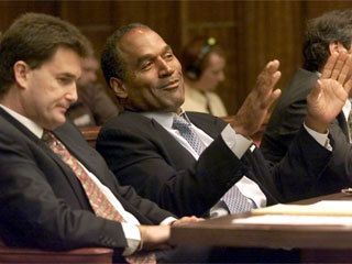 "<div class=""meta image-caption""><div class=""origin-logo origin-image ""><span></span></div><span class=""caption-text"">O.J. Simpson, right, gestures as he talks with his attorney Yale Galanter, left, in Miami circuit court Wednesday, Oct. 10, 2001, in Miami for the second day of jury selection for his trial.  (AP Photo/Wilfredo Lee)</span></div>"