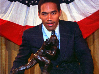 "<div class=""meta image-caption""><div class=""origin-logo origin-image ""><span></span></div><span class=""caption-text"">Southern Cal's O.J. Simpson poses with the Heisman Trophy at New York's Downtown Athletic Club in this Dec. 5, 1968 photo.  (AP)</span></div>"