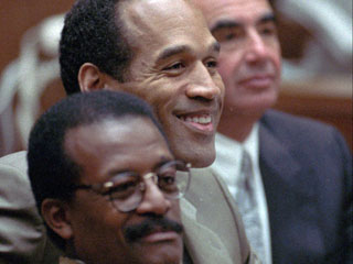 "<div class=""meta image-caption""><div class=""origin-logo origin-image ""><span></span></div><span class=""caption-text"">O.J. Simpson smiles as Judge Lance Ito talks to the jury during a brief court session in Los Angeles Wednesday morning, March 1, 1995. Ito brought the jury into the courtroom to inform them that one of the jurors, a 46-year-old African-American man, had been dismissed. Foreground is Johnnie Cochran Jr. and background is Robert Shapiro. (AP Photo/Pool, Hal Garb)</span></div>"