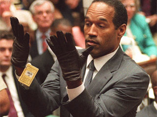 "<div class=""meta image-caption""><div class=""origin-logo origin-image ""><span></span></div><span class=""caption-text"">O.J. Simpson holds up his hands before the jury after putting on a new pair of gloves similar to the infamous bloody gloves during his double-murder trial in Los Angeles in this June 21, 1995 photo. (AP Photo/Vince Bucci, Pool)</span></div>"
