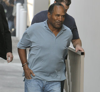 "<div class=""meta image-caption""><div class=""origin-logo origin-image ""><span></span></div><span class=""caption-text"">Former NFL player O.J. Simpson is transferred to the Clark County Detention Center in Las Vegas, Sunday, Sept. 16, 2007. A prosecutor in Las Vegas says O.J. Simpson ""is facing a lot of time"" in connection with an alleged armed robbery. Plans are to charge him with several felonies, including two counts of robbery with use of a deadly weapon, which could carry a maximum 35 years each.  (AP Photo/Jae C. Hong)</span></div>"