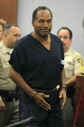 "<div class=""meta image-caption""><div class=""origin-logo origin-image ""><span></span></div><span class=""caption-text"">O.J. Simpson appears in a Clark County Justice courtroom for his arraignment in Las Vegas, Wednesday, Sept. 19, 2007.  (AP Photo/Jae C. Hong, Pool)</span></div>"