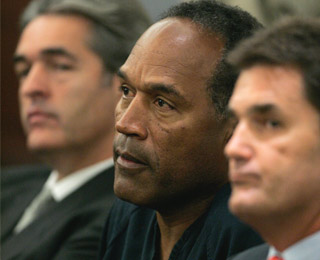 "<div class=""meta image-caption""><div class=""origin-logo origin-image ""><span></span></div><span class=""caption-text"">O.J. Simpson, center, is flanked by his lawyers Yale Galanter, right, and Gabriel Grasso during Simpson's arraignment in a Clark County Justice courtroom for his arraignment in Las Vegas, Wednesday, Sept. 19, 2007.  (AP Photo/Jae C. Hong, Pool)</span></div>"