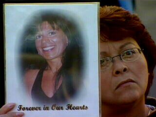 "<div class=""meta image-caption""><div class=""origin-logo origin-image ""><span></span></div><span class=""caption-text"">A woman holds a picture of a loved one killed on 9/11. </span></div>"
