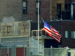 "<div class=""meta ""><span class=""caption-text "">A flag flies at half-mast to remember FDNY members who died on 9/11.</span></div>"