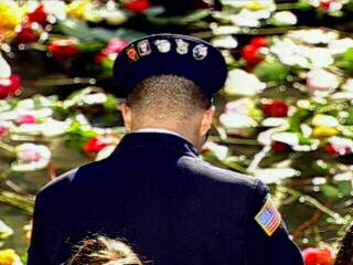 "<div class=""meta image-caption""><div class=""origin-logo origin-image ""><span></span></div><span class=""caption-text"">A fireman bows his head in remembrance of fallen comrades. </span></div>"