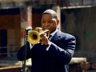"<div class=""meta ""><span class=""caption-text "">Jazz musician Wynton Marsalis plays his trumpet at Ground Zero. </span></div>"
