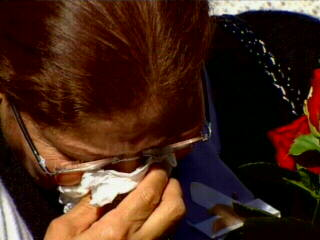 "<div class=""meta ""><span class=""caption-text "">A mourner buries her face in a tissue during the ceremony. </span></div>"