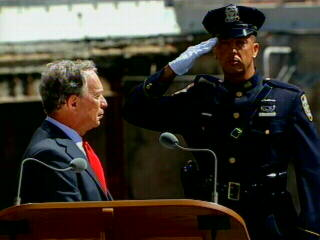 "<div class=""meta ""><span class=""caption-text "">An officer salutes while Mayor Michael Bloomberg watches during the NYPD and FDNY rendition of Taps, which closed the ceremony. </span></div>"
