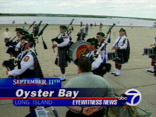 "<div class=""meta ""><span class=""caption-text "">Residents attend a 9/11 ceremony in Oyster Bay, Long Island.</span></div>"