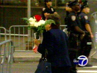 "<div class=""meta ""><span class=""caption-text "">A woman carries flowers shortly before the 9/11 ceremony begins.</span></div>"