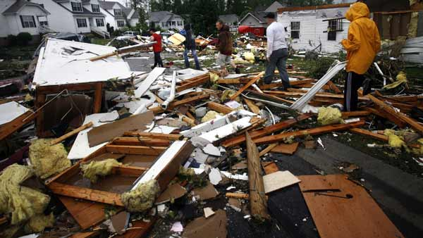 "<div class=""meta image-caption""><div class=""origin-logo origin-image ""><span></span></div><span class=""caption-text"">Three tornadoes destroyed homes and tossed cars and injured more than 200 people Monday.</span></div>"