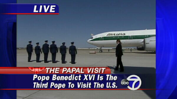 A crew waits for the arrival of the pope.