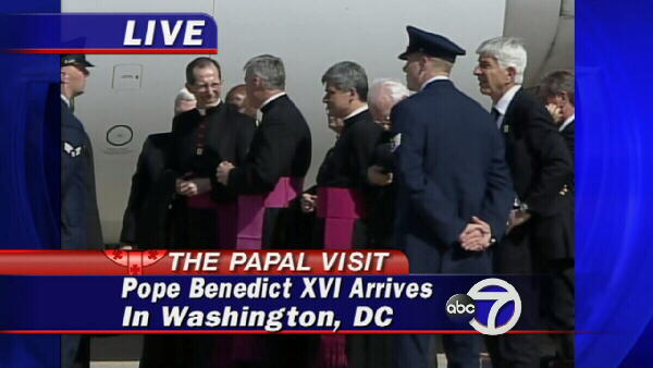 Religious officials wait to greet the pope.