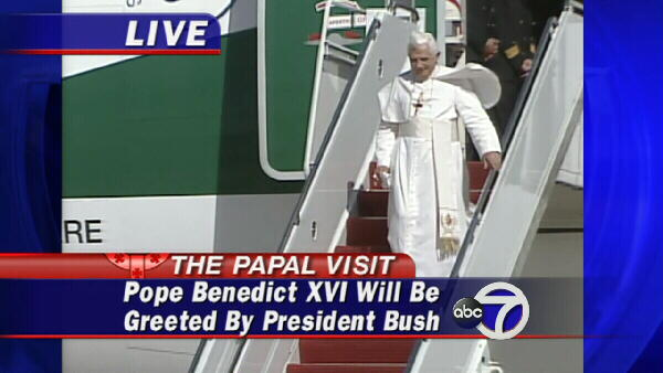 Pope Benedict exits the plane, descending the stairs by himself.