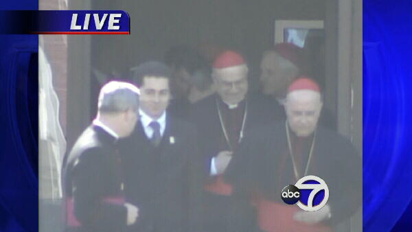 Cardinals exit meeting between Bush and Pope Benedict XVI.