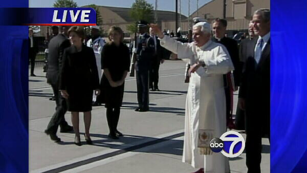 Pope Benedict XVI waves to the crowd.