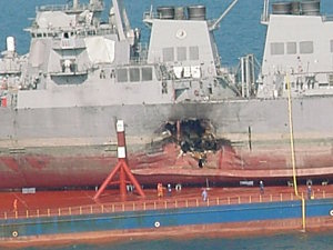 "<div class=""meta image-caption""><div class=""origin-logo origin-image ""><span></span></div><span class=""caption-text"">The USS Cole aboard a Norwegian rescue ship.</span></div>"