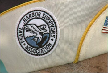 "<div class=""meta ""><span class=""caption-text "">A close-up of the patch of the Pearl Harbor Survivors Association</span></div>"