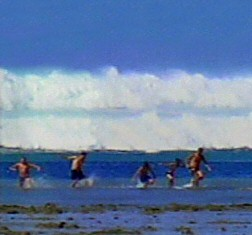 January 2005This family photo shows people playing as one of the huge waves bears down on them.