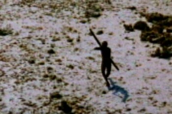 January 2005A tribesman who survived the tsunami on a remote island in the Indian Ocean shoots with a bow and arrow at a helicopter bringing relief supplies.