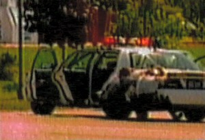 9/2/2003: Troopers crouch behind their cruiser when the bomb explodes.