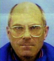 9/2/2003: A photograph of the man who was killed by the bomb locked around his neck, Brian Wells.